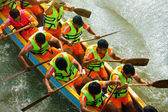 People rowing dragon boat in racing — Stock Photo