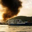 Постер, плакат: Mekong Delta ferry boat on sea black smoke