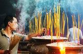 People burn incense at ancient pagoda — Stock Photo