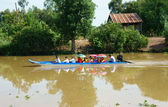 People on boat, reflect on Mekong Delta canal — Stock Photo