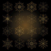 Collection of golden glowing snowflakes — Stock Vector