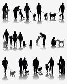 People and dogs — Stock vektor