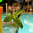 Cocktail by the pool — Stock Photo