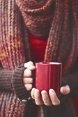 Hands holding mug of drink — Stock Photo