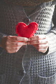 Red heart in hands — Stok fotoğraf