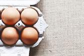 Chicken eggs in a box — Stock Photo