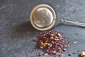 Dried Tea and tea strainer — Stock Photo