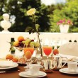 Rich breakfast on the balcony — Stockfoto