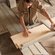 Young worker in joinery — Stock Photo #40923655