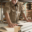 Young worker in joinery — Stock Photo #40924873