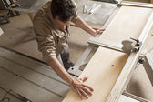 Young worker in joinery — Stock Photo