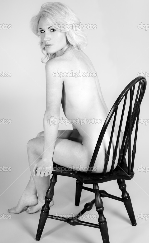 Sey Nude Woman Sitting On A Chair Stock Image