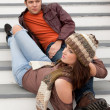 Couple sitting on a stairs — Stockfoto