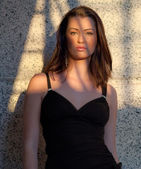 Woman Partly in Shadow — Stock Photo