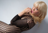 Woman in Fishnet Bodysuit — Stock Photo