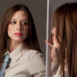 Woman Looking At Self in Mirror — Stock Photo