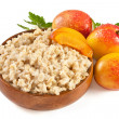 Porridge with fresh peach — Stock Photo
