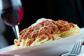 Bolognese and red wine — Stock Photo