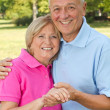 Seniors posing with hands — Stock Photo