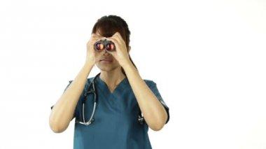 Nurse looking through binoculars — Stock Video