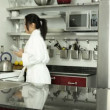 Asigirl taking pills in kitchen — Stock Video #31675543