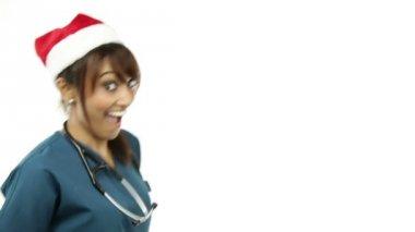 медсестра танцует в рождество шляпу — Стоковое видео