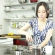 Beautiful asian woman in the kitchen — Stock Video