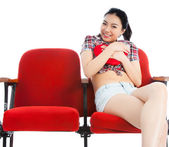 Attractive Asian girl 20s at the theatre isolate white backgroun — Stock Photo