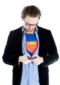 Attractive caucasian man in Superman clothes writes sms — Stock Photo