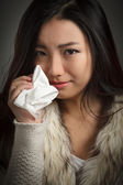 Attractive asian girl cries and wipes her tears with a handkerchief — Stock Photo
