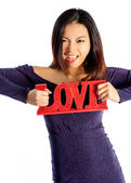 Asian girl holding LOVE sign — Stock Photo