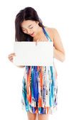 Attractive asian girl holding blank sheet of paper — Stock Photo
