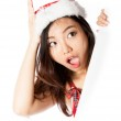 Edge of the page Sexy asian santa claus astonished — Stock Photo #33617311