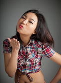 Portrait of sexy asian cowgirl blowing a kiss — Stock Photo