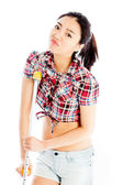 Isolated on white sexy asian cowgirl injured with a crutch — Stock Photo