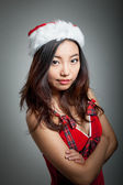 Sexy asian santa claus on grey backgroound upset with her arms c — Stock Photo