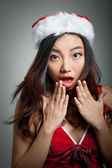 Sexy asian santa claus on grey backgroound scared — Stock Photo