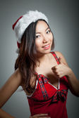 Sexy asian santa claus on grey backgroound with a thumb s up — Stock Photo