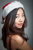 Sexy asian santa claus on grey backgroound proud — Stock Photo