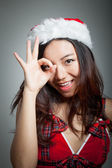Sexy asian santa claus on grey backgroound with zero hand gestur — Stock Photo
