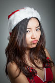 Sexy asian santa claus on grey backgroound upset — Stock Photo