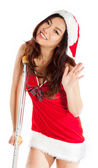 Sexy asian santa claus injured with crutch waving — Stock Photo