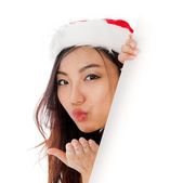 Edge of the page Sexy asian santa claus blowing a kiss — Stock Photo