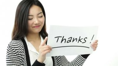 "Attractive asian girl with ""thanks"" sign — Stock Video"