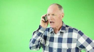 Senior man upset while talking on the phone — Stock Video