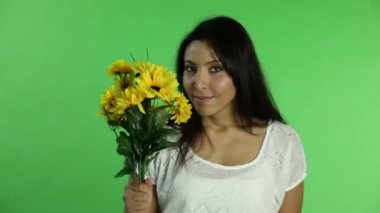 Casual woman with summer flowers — Stock Video