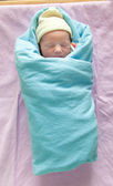 Child in swaddling clothes — Stock Photo