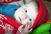 Baby in red jacket — Stock Photo
