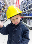Boy in yellow protective helmet — Stockfoto