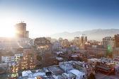 City in sunbeams — Stock Photo